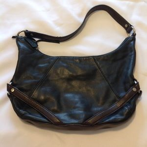 Black purse with brown trim Leather